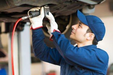 Mechanician changing car wheel