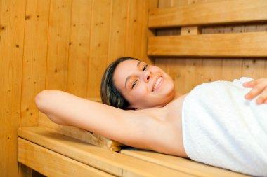 woman relaxing a sauna