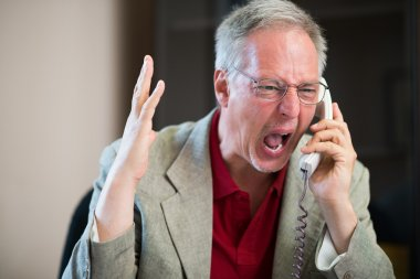 Angry man yelling on phone