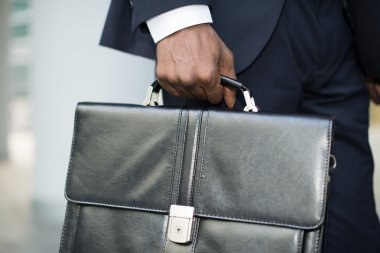Businessman holding his briefcase