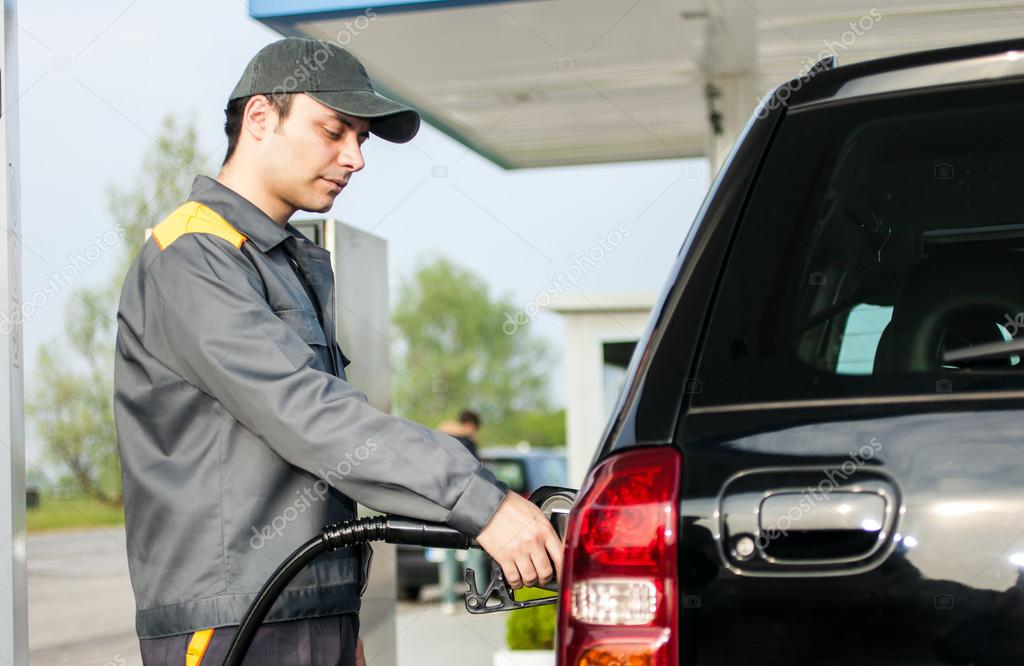 gas station attendant at work stock photo