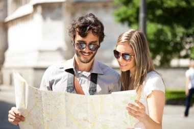 tourists reading a map in the city