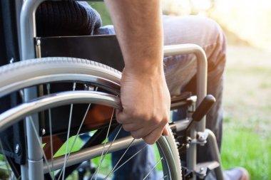 Paralyzed man using wheelchair
