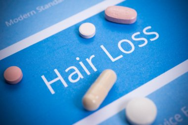 Hair loss concept with different pills