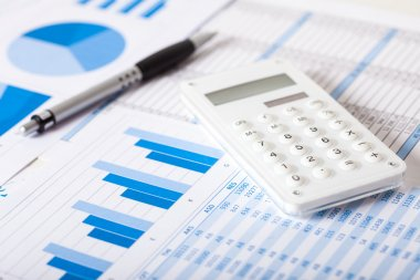pen, calculator and paperwork