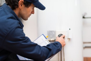 Technician adjusting regulator