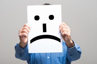 Man holding a sad face
