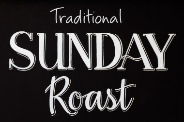 Traditional sunday roast on a chalk board