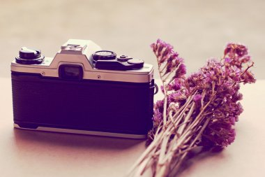 Old camera and bunch of flowers