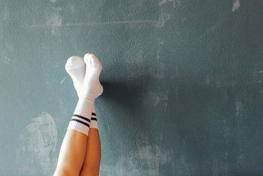 legs raised on wall
