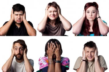 Six people cover their ears or heads