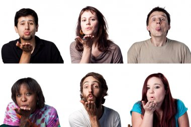 Group of people blowing a kiss