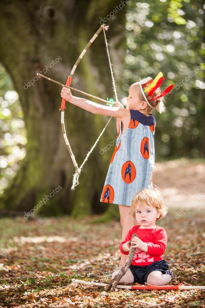 Girl playing with a bow