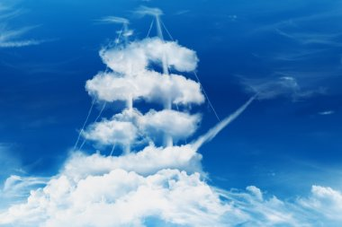 Pirate ship or sail boat in the shape of a sea of clouds concept.