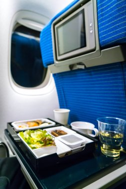 Tray of food on plane .
