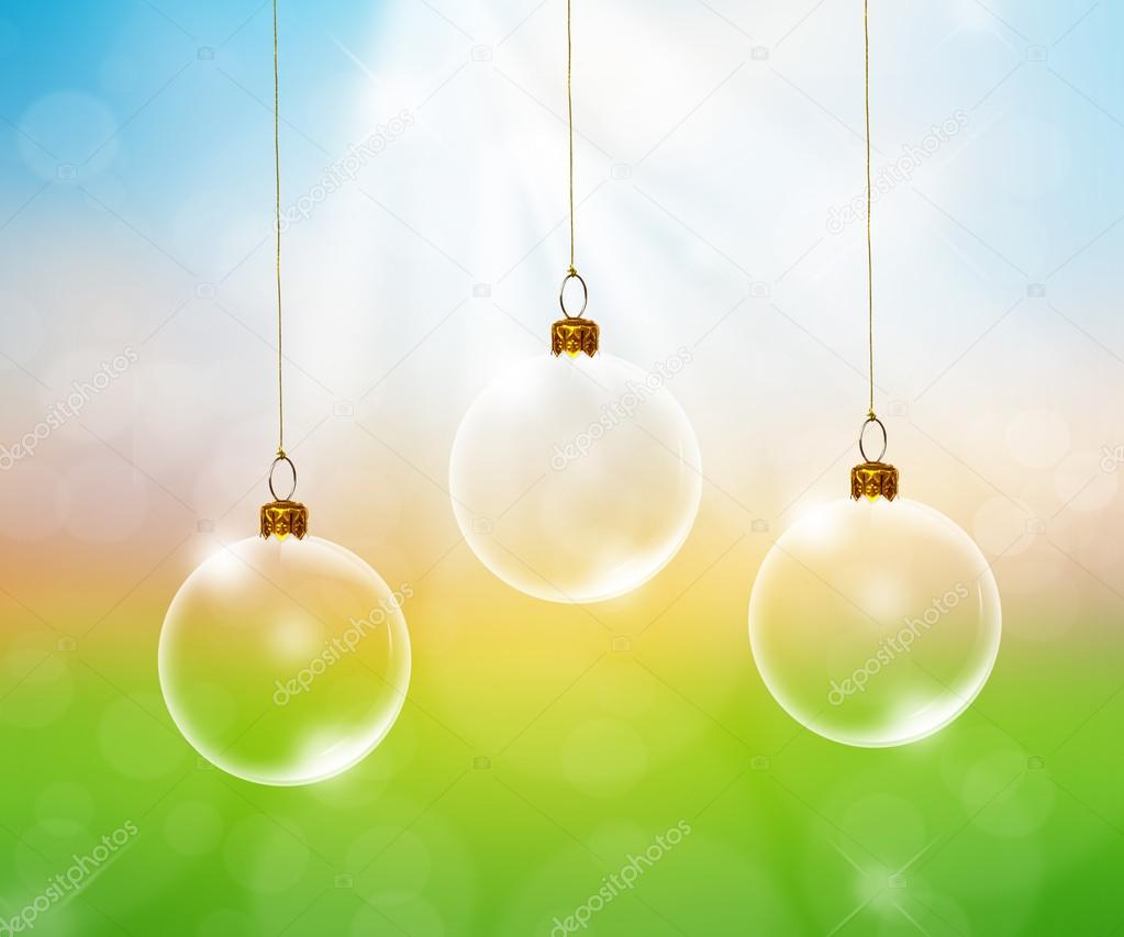 Transparent Christmas ball over green forest