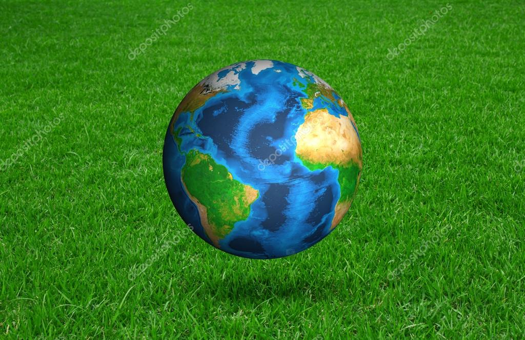 Earth in Fresh spring green grass (Elements of this image furnis