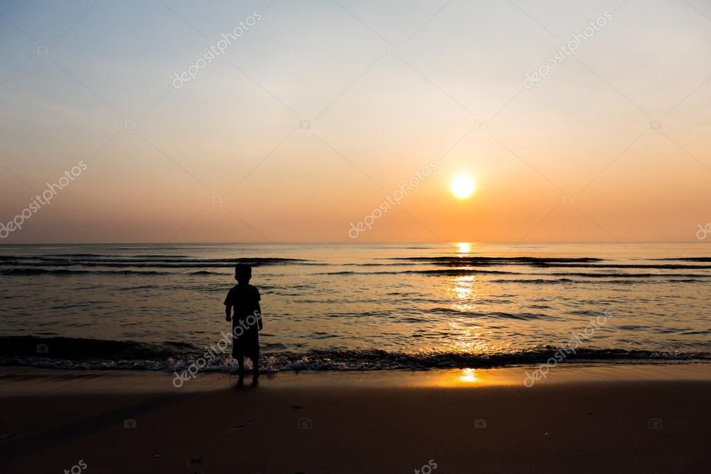 Silhouette of child on the beach