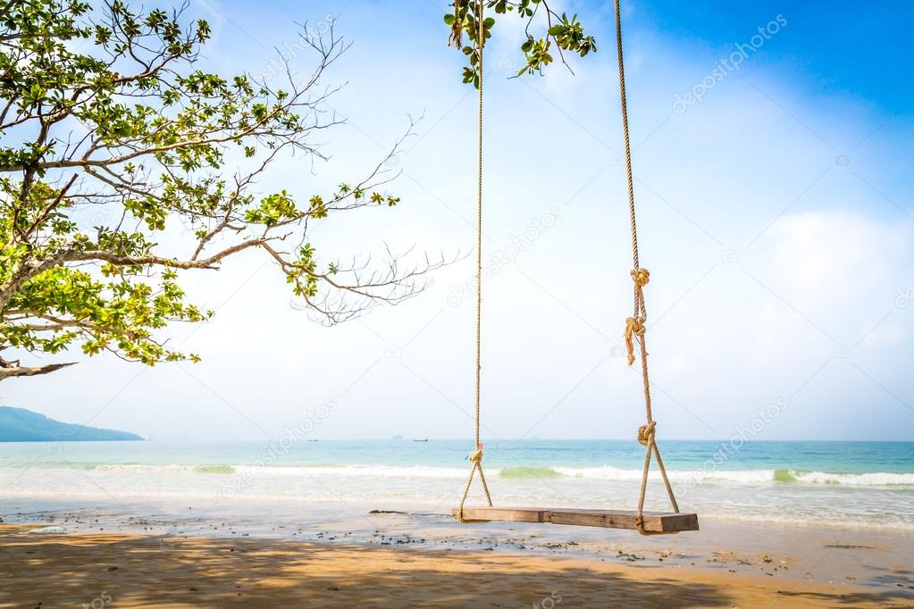 A swing on tropical beautiful  beach