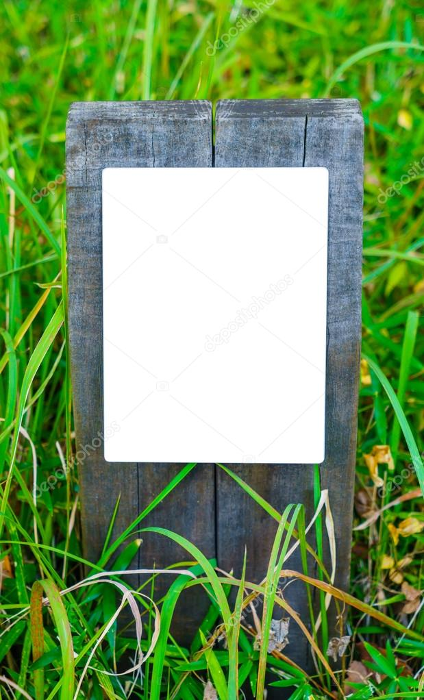 Wooden sign on grass