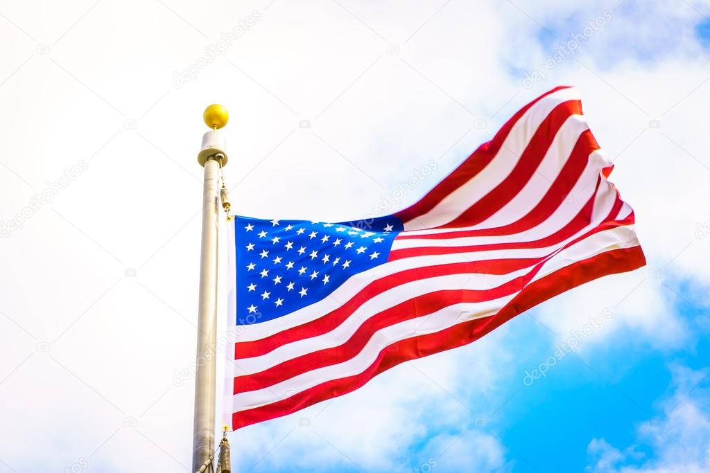 American flag on blue sky