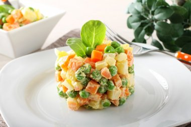 Russian salad with peas, carrots, potatoes and mayonnaise
