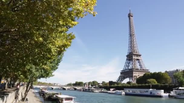 Eiffel tower and Seine river in a sunny day in Paris, hand held