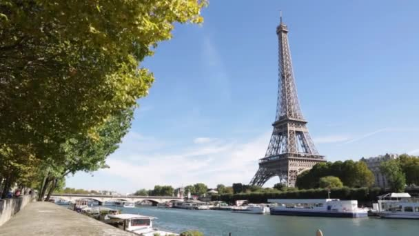 Eiffel tower and Seine river in a sunny day in Paris, windy