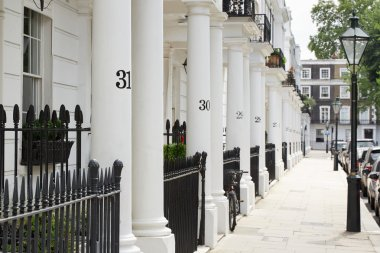 Row of beautiful white edwardian houses in Kensington, London