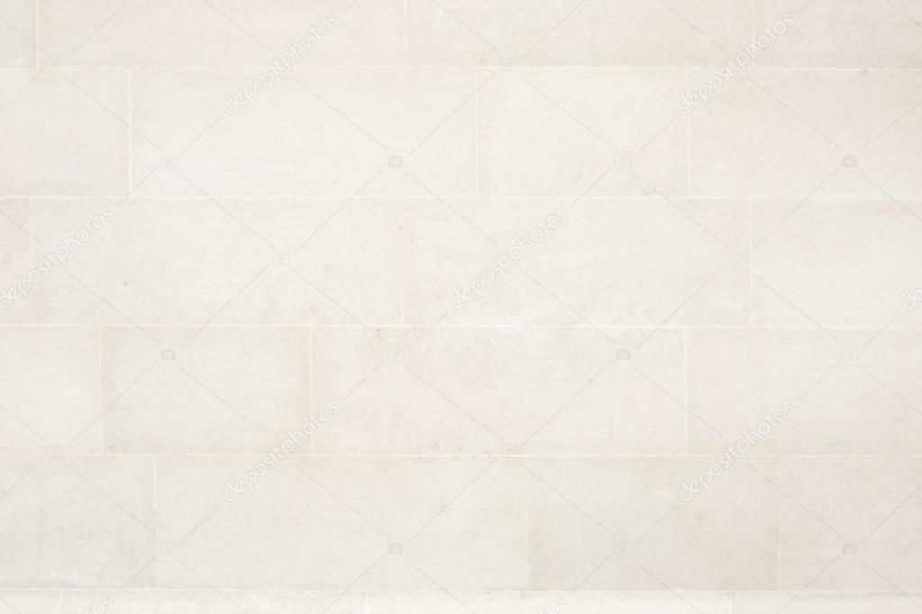 Piastrelle beige fondo di struttura della parete di pietra u foto