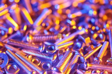 Nuts and bolts background in bright colorful lights