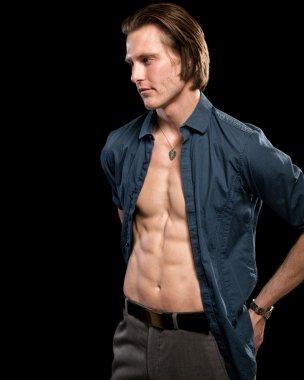 Attractive man with shirt open. Studio shot over black. stock vector