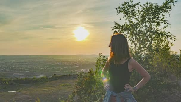 Girl at sunset with landscape