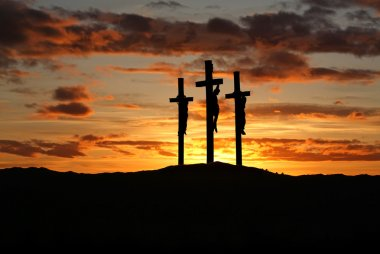 Three crosses over bright sunset with copy space
