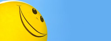 Smiling balloon in the sky