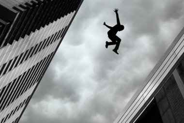 Man Jumping off Building