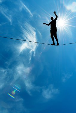 Silhouette of man on the rope concept of risk taking and challen