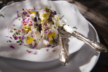 Goat cheese with edible flowers