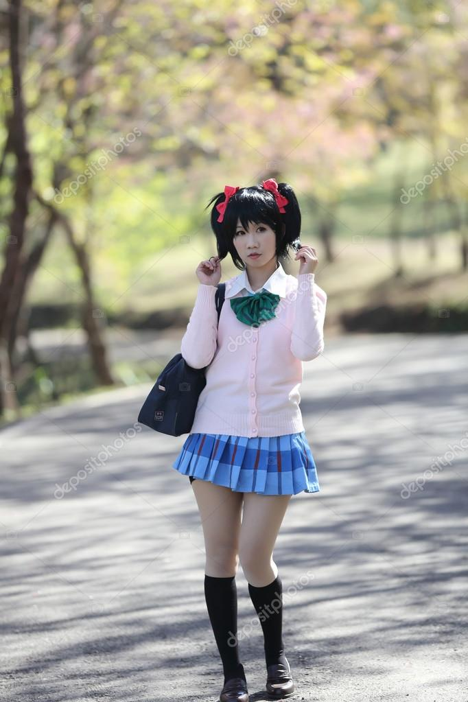Asian Schoolgirl With Nature Stock Image