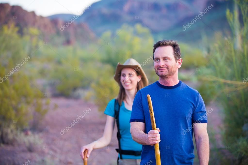 Desert Hikers on Mountain Path
