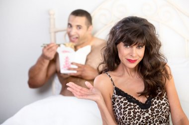 Mature woman with her boyfriend in bed