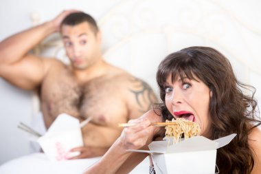 Mature woman eating soppily with Boyfriend