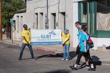 People with GLBT Chamber of Commerce Sign at AIDSwalk
