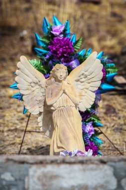 Winged Angel Sculpture on Grave