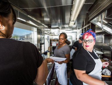 Chef works alongside crew on food truck