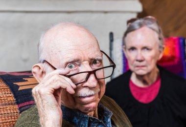 Concerned elderly couple