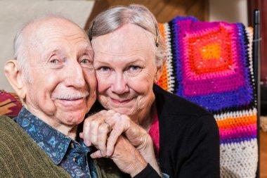 elderly couple sitting in living-room