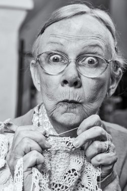 Woman with crochet and funny expression