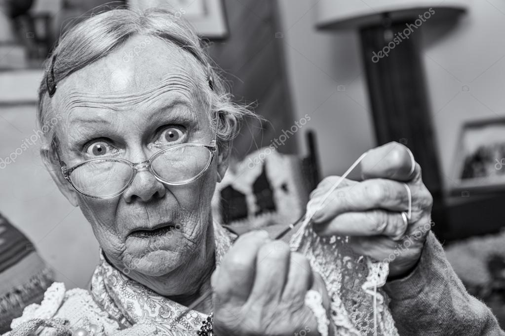 Surprised woman crocheting