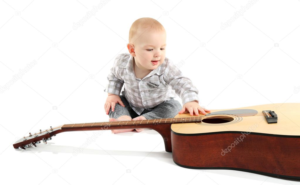 Cute baby with guitar — Stock Photo © belchonock #101629280